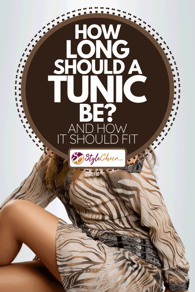 Model wearing a tunic with animal print, How Long Should A Tunic Be? [And How It Should Fit]