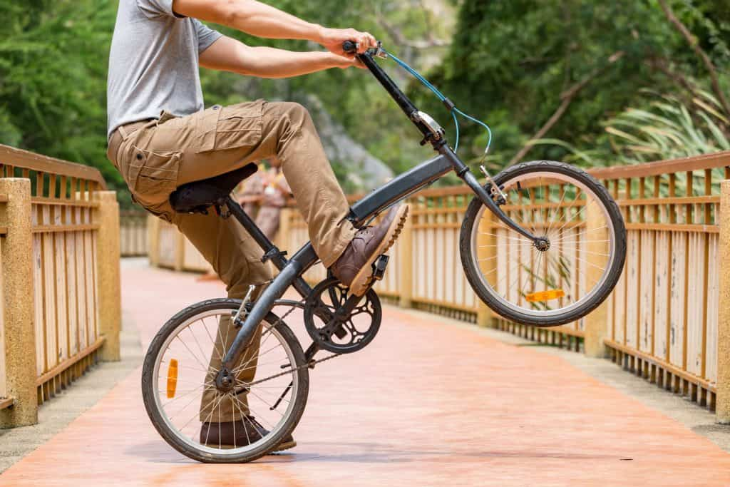 Man wearing cargo pants and his bicycle, How Long Should Cargo Pants Be?