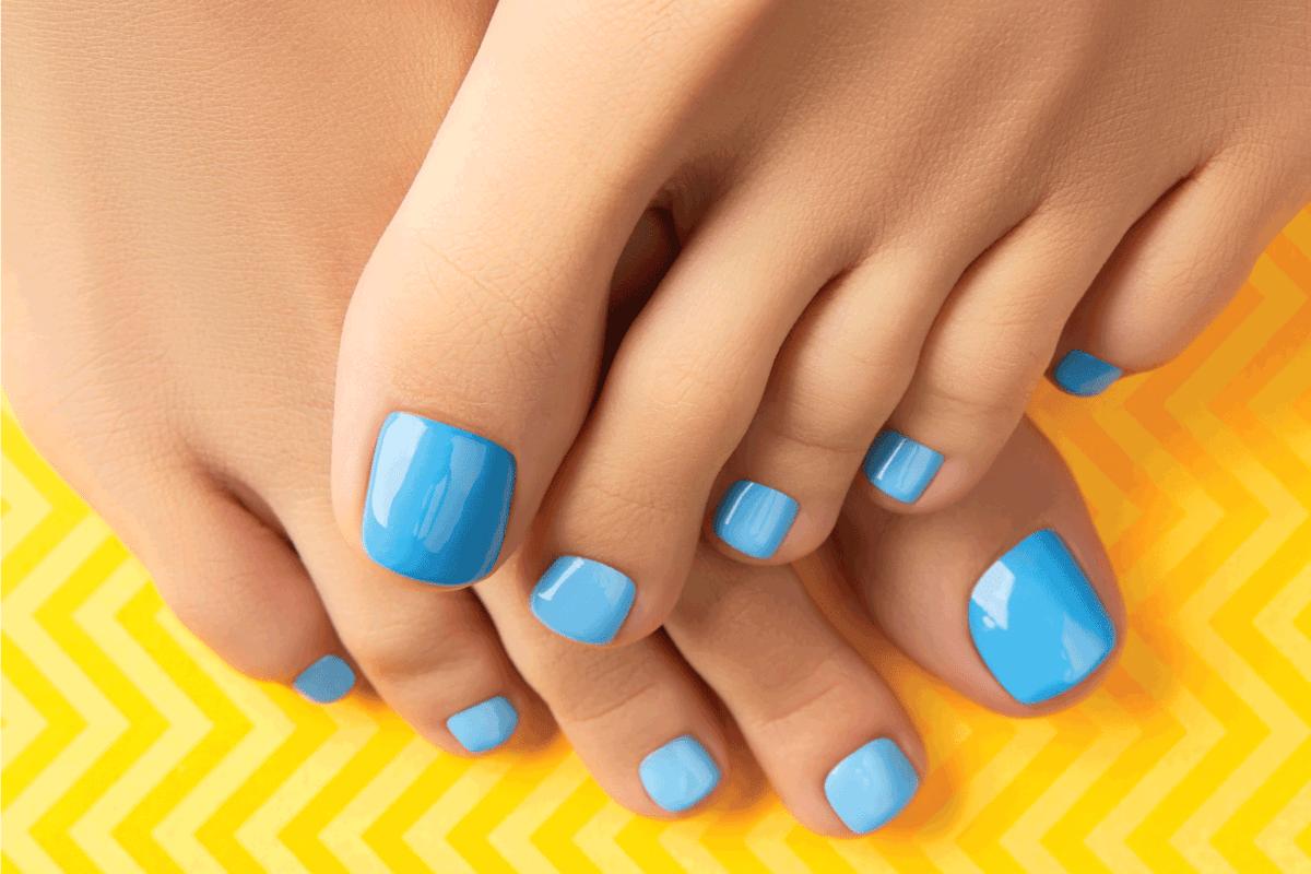 Manicure, pedicure beauty salon concept. Womans feet. Beautiful summer nail design.