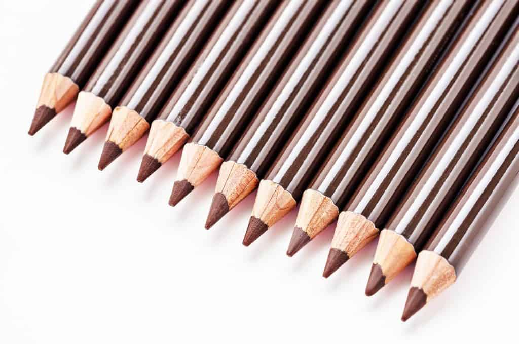 Brown eyebrow pencils on white background
