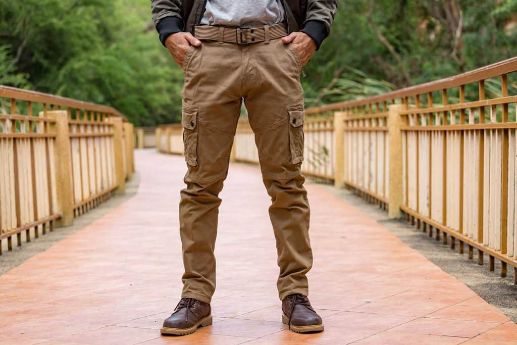 Model wearing cargo pants and leather shoes