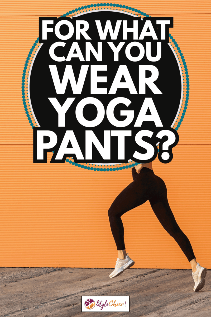 Motivated confident fit woman athlete in tight sportswear, black pants and top, starting to run, jogging outdoor against orange wall. For What Can You Wear Yoga Pants