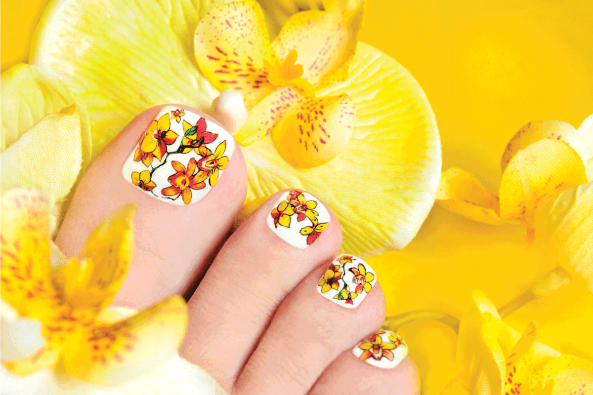 Pedicure with yellow orchids.