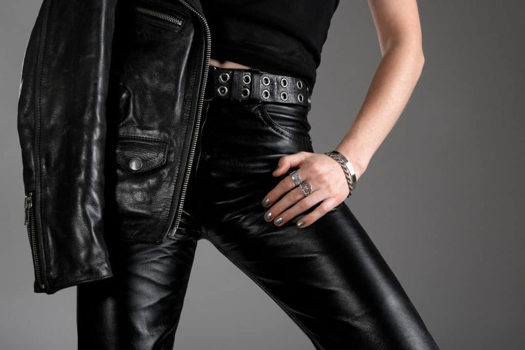 Person wearing black leather pants and jacket with zippers