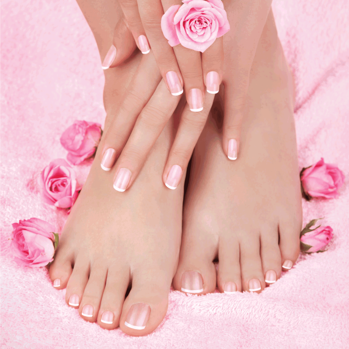 Skincare of a beauty female feet with pink roses and chic french tips