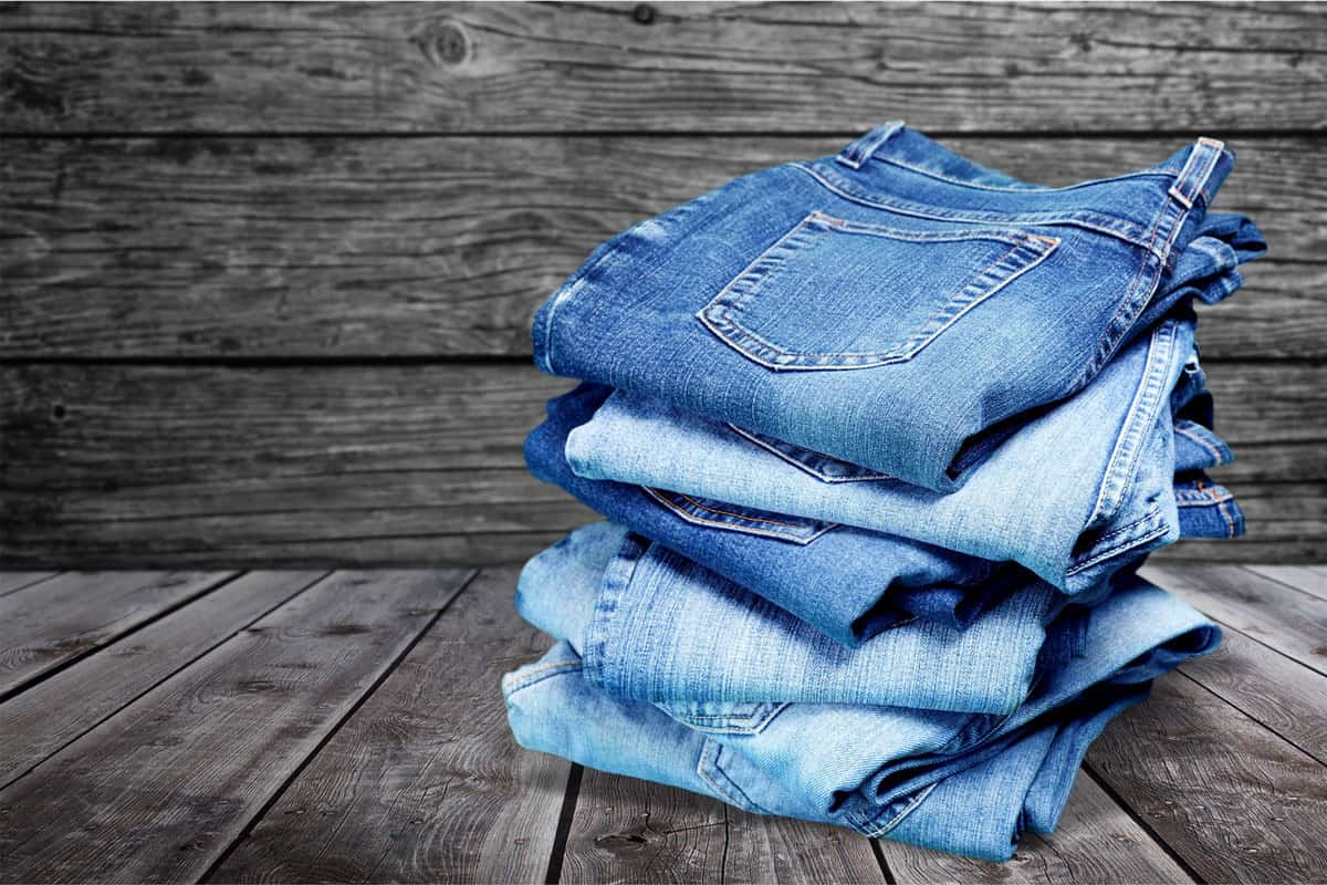 Stack of jeans isolated on white background, Do Jeans Shrink Or Stretch?