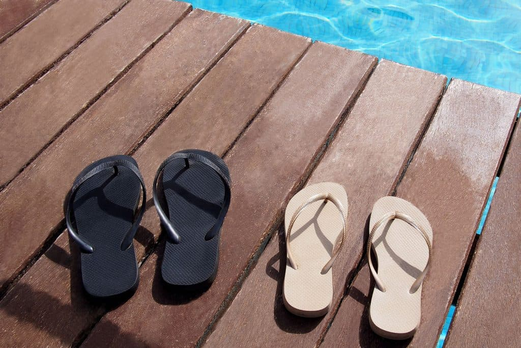 Two pairs of flip flops left on the patio