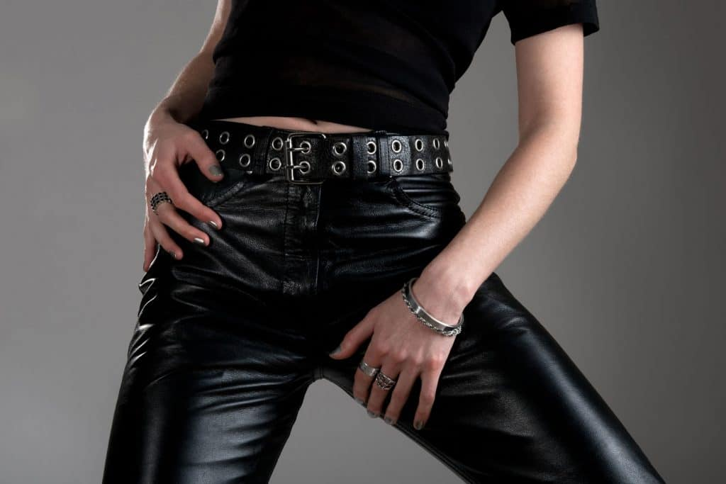 Young woman in black leather pants, wearing metal jewellery, How To Get Wrinkles Out Of Leather Pants [Inc. Faux Leather!]