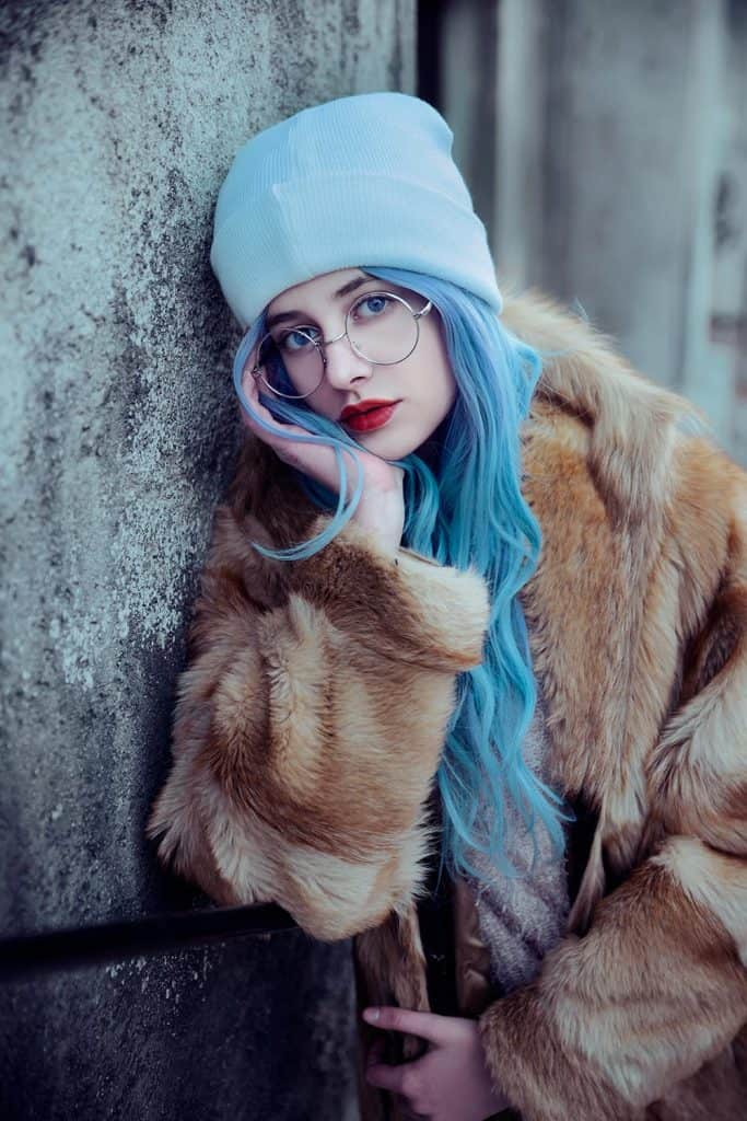 Young woman wearing fur coat and eyeglasses