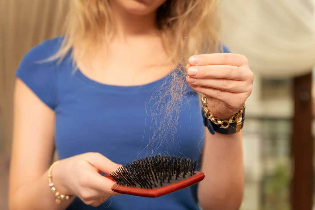 Young woman worried about hair loss