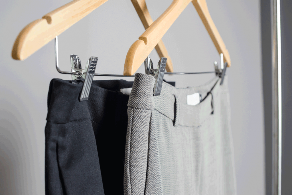 close up view black and grey female pans on hangers with isolated background. new collection of office clothes. What Shoes Go With Chinos [For Men And Women]
