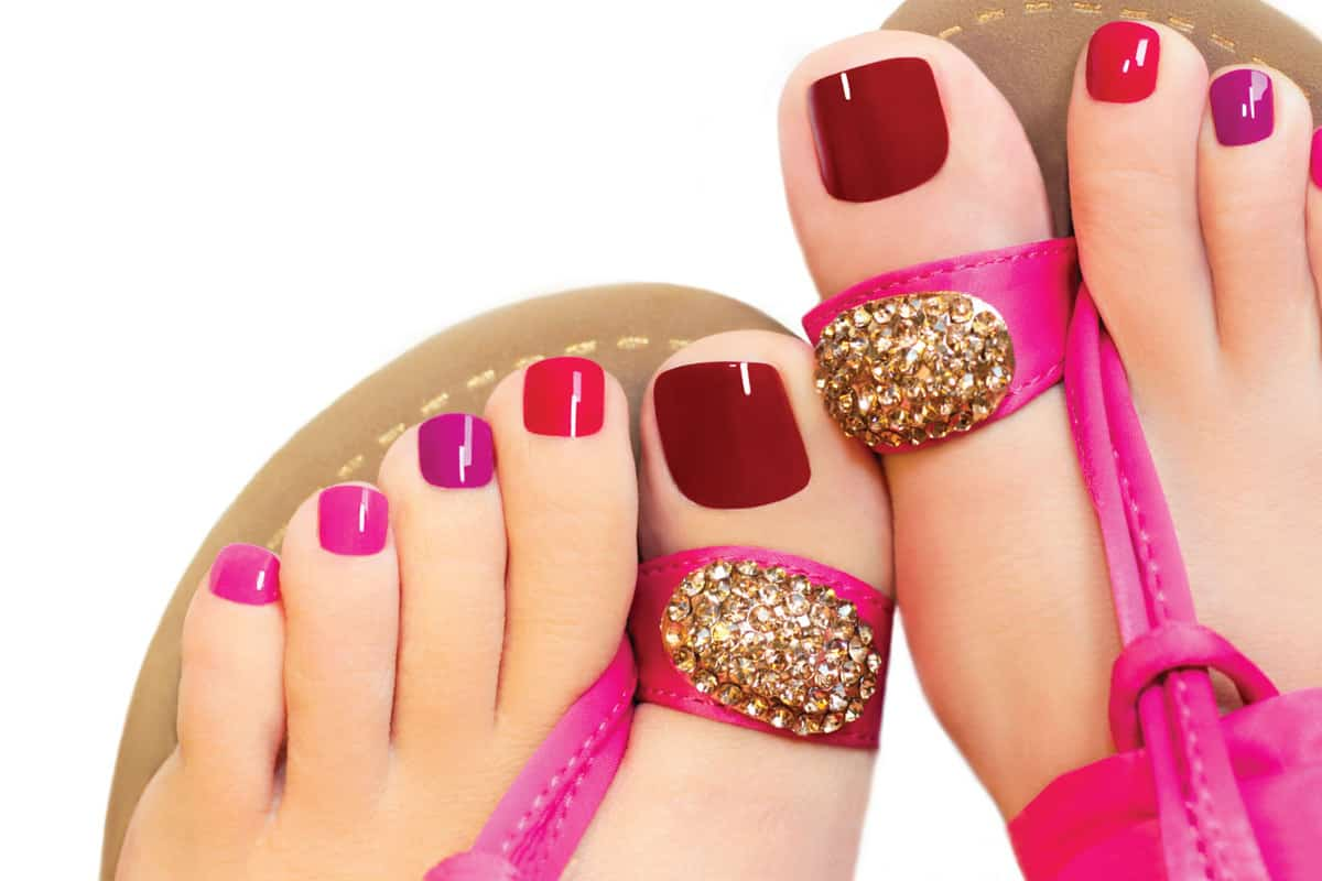 shades of pink color pedicure on the toenails