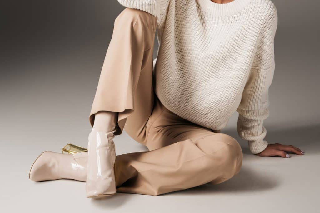 A beautiful woman wearing a white blouse and tan pants, What Color Shoes Go With Tan Pants?