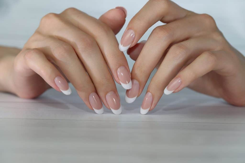 A woman showing her manicure