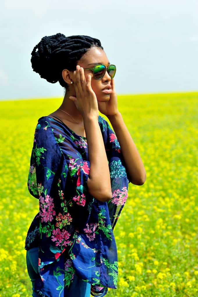 African American girl wearing sunglasses, close-up portrait