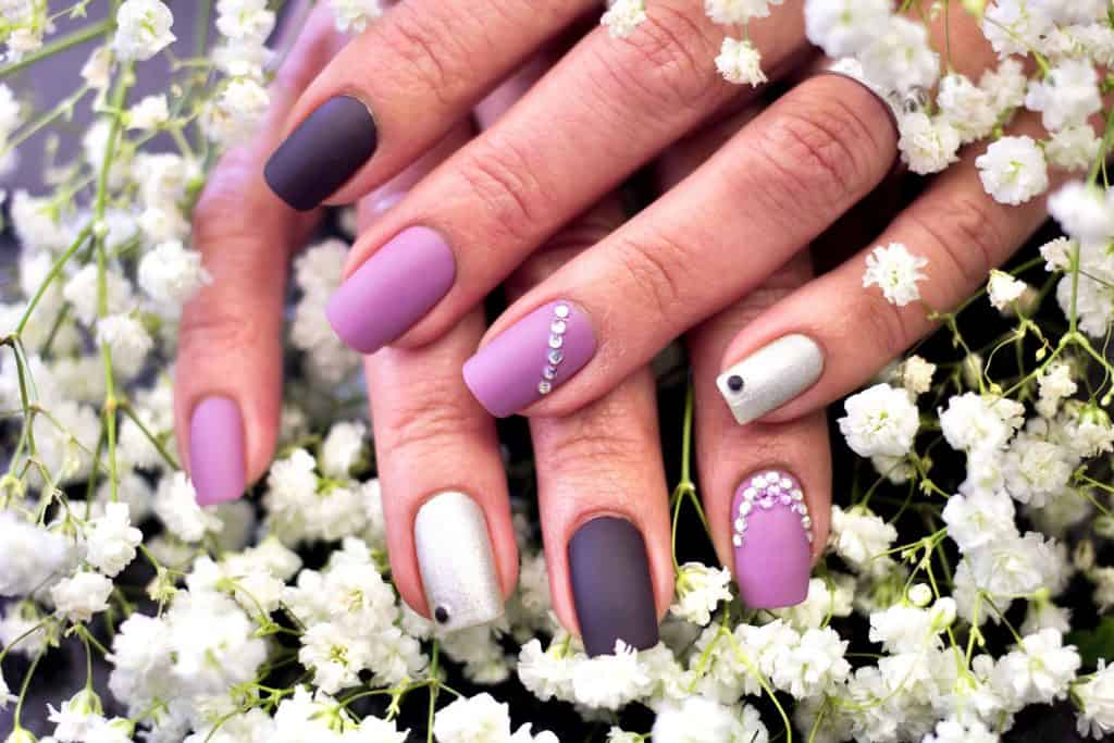 Beautiful purple nail polish decorated with diamonds, What Nail Color Goes With A Pink Dress?