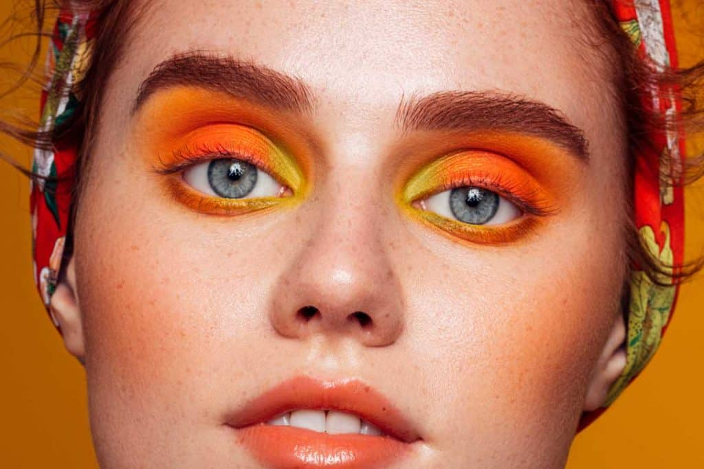 Beautiful woman with bright orange make-up, What Color Eyeshadow For Hooded Eyes?