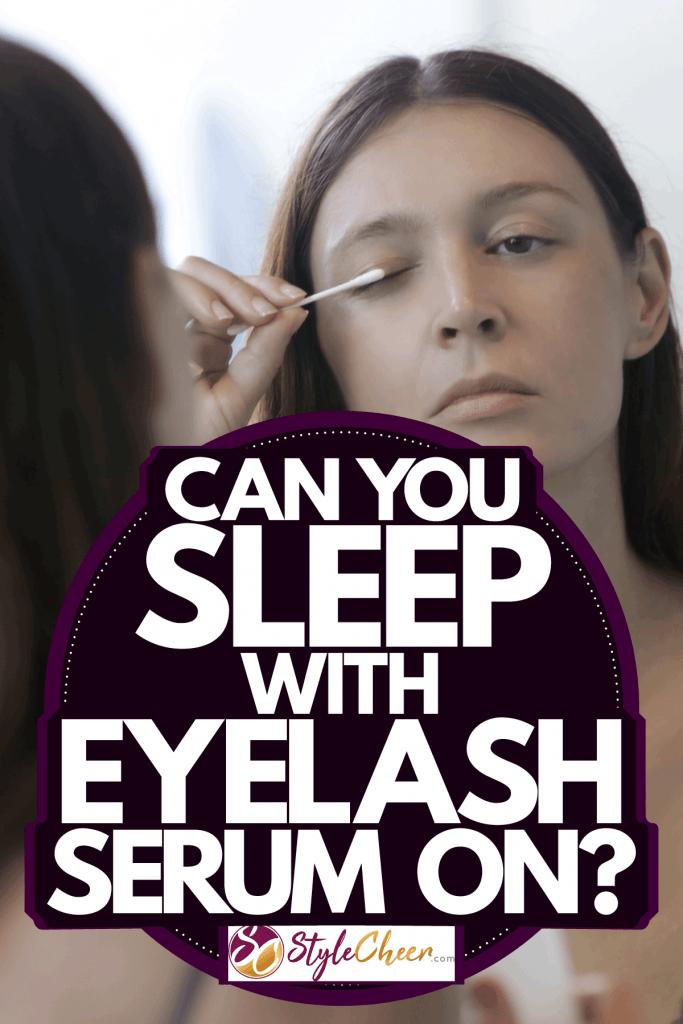 A woman putting on eyelash serum on her eyelashes, Can You Sleep With Eyelash Serum On?