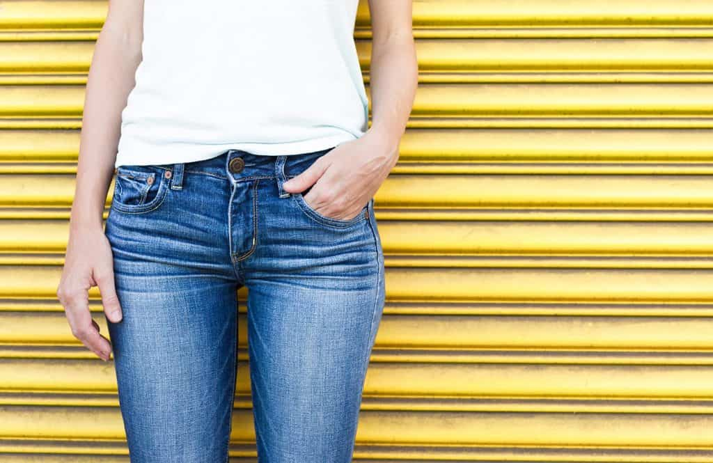 Close up of a female wearing jeans