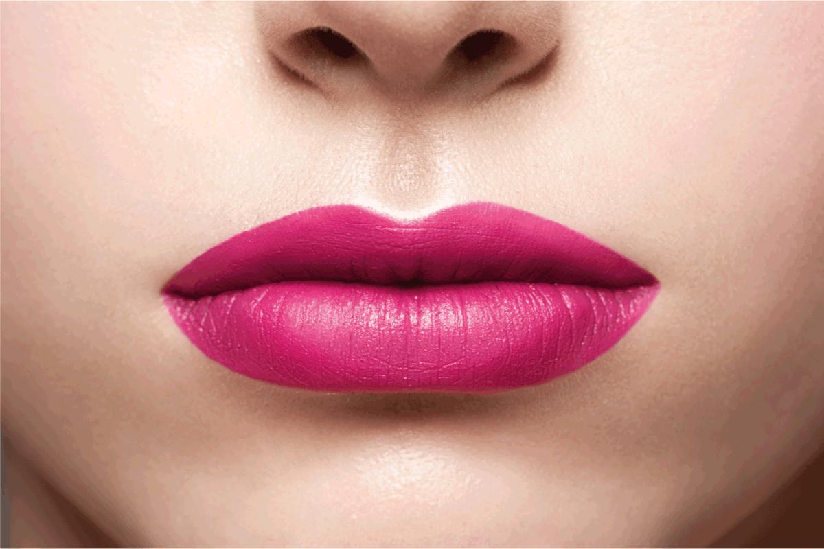 Closeup shot of sexy woman lips with fuchsia lipstick