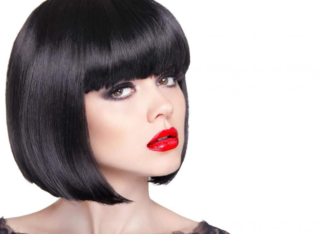 Portrait of beautiful brunette woman with red lips