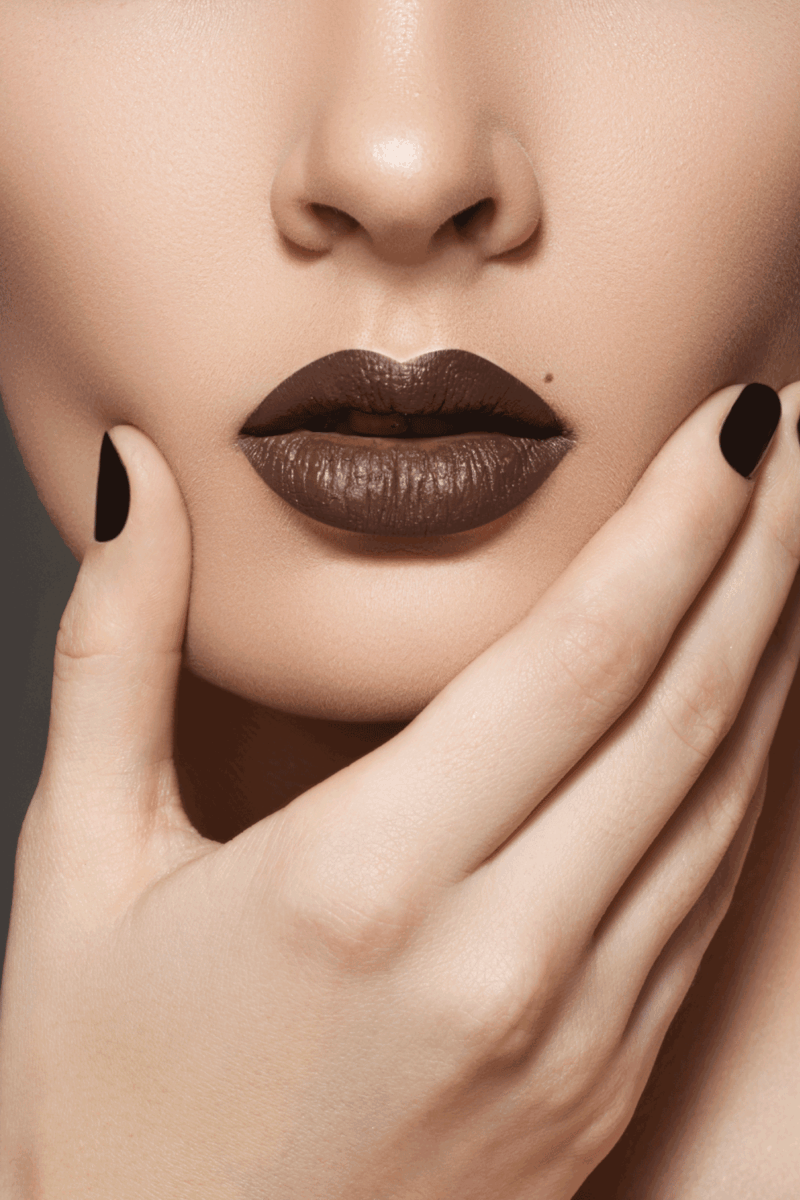 Fashion style, manicure, cosmetics and make-up. Dark lips make-up