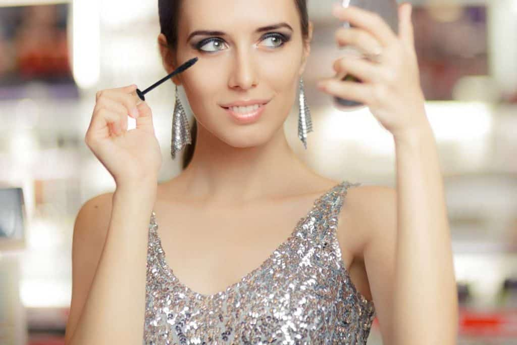 Glamour woman with mascara and makeup mirror, What Color Eyeshadow To Wear With A Silver Dress