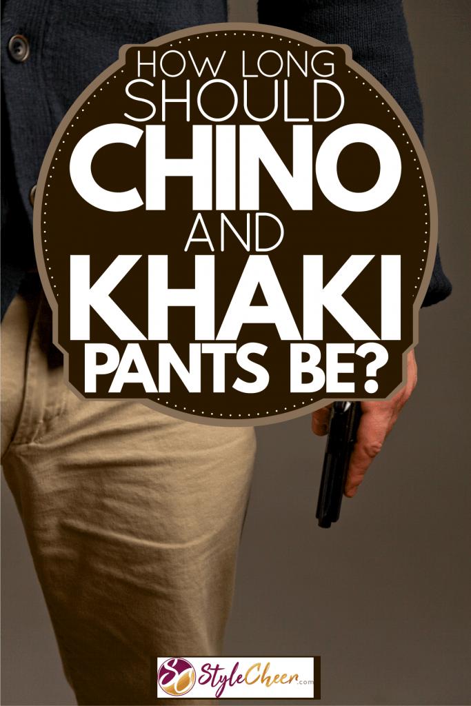 A man wearing khaki pants and holding his wallet, How Long Should Chino And Khaki Pants Be?