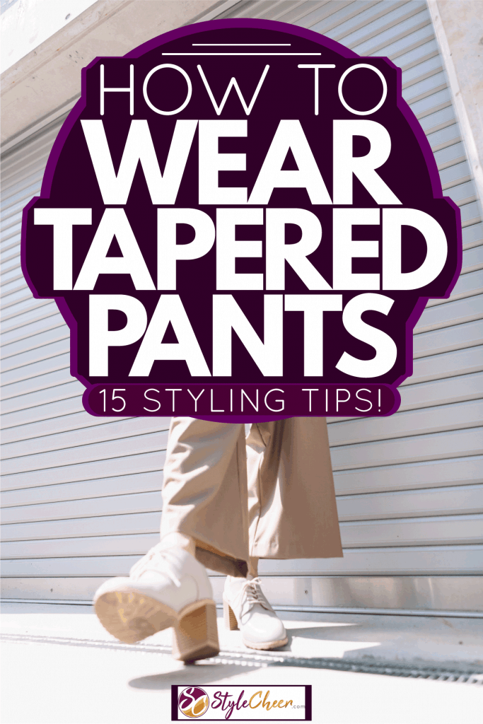 A woman wearing a blue blouse khaki pants and high heeled shoes, How To Wear Tapered Pants - 15 Styling Tips!