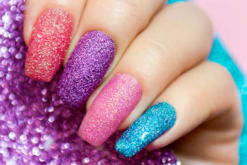 Multicolored shiny manicure on long nails close-up, How To Apply Chunky Glitter To Gel Nails
