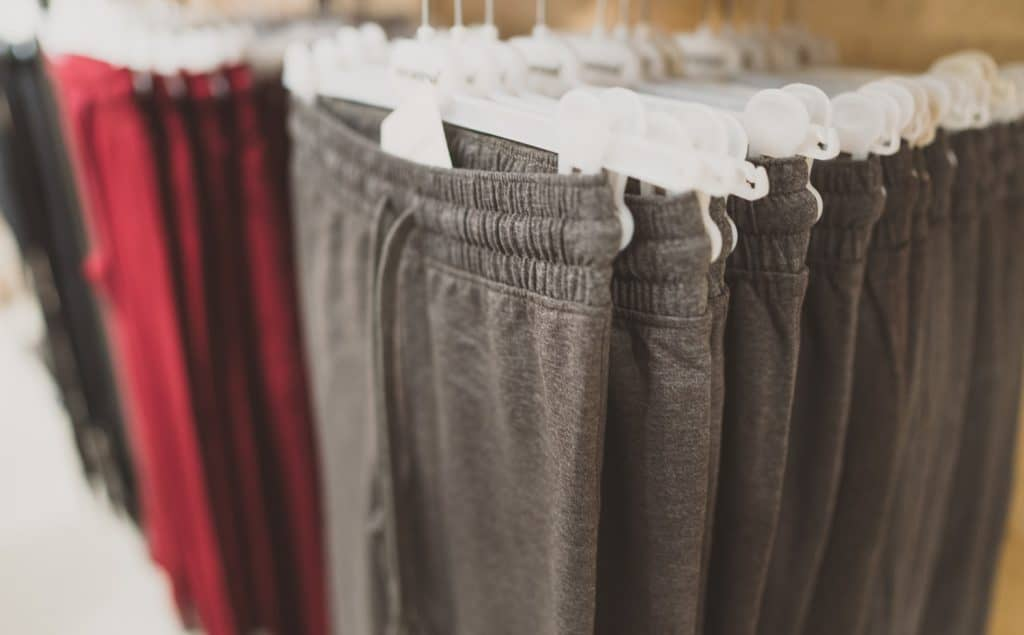 Rack with sweatpants in clothing store.