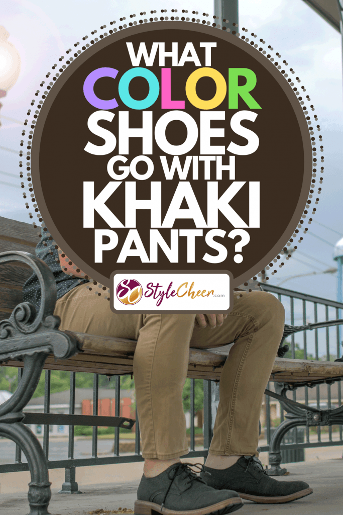 A man sitting on the bench wearing khaki pants and black leather shoes, What Color Shoes Go With Khaki Pants?