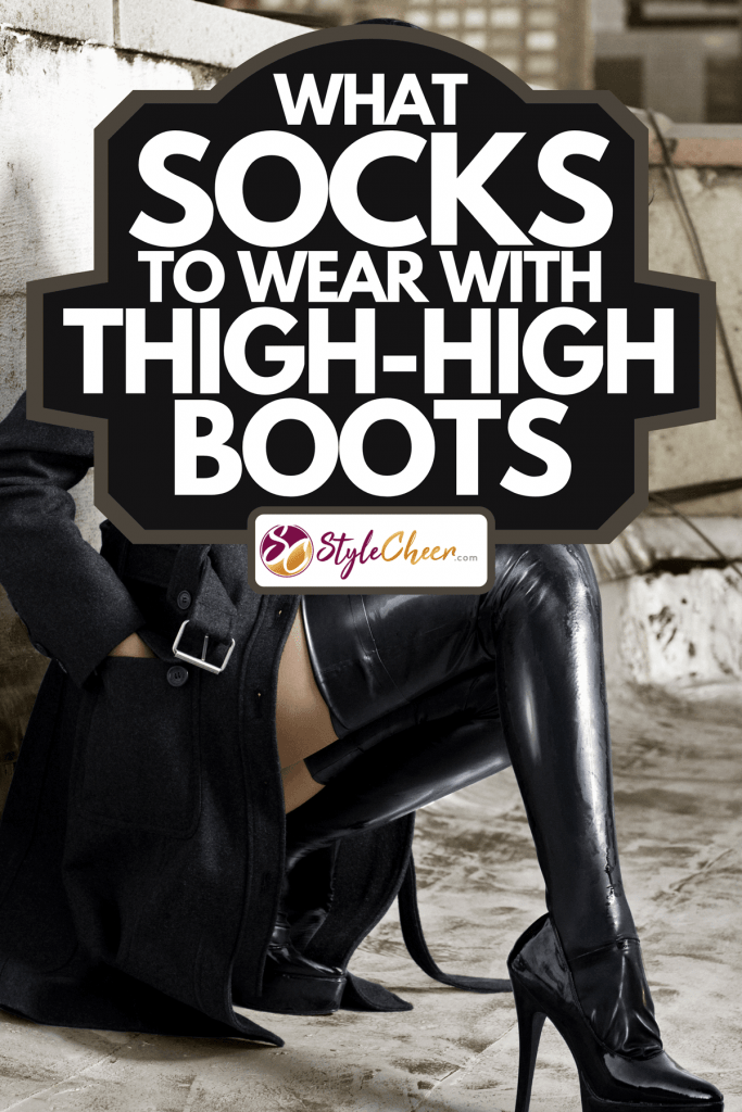 A woman wearing black thigh-high boots on a rooftop, What Socks To Wear With Thigh-High Boots