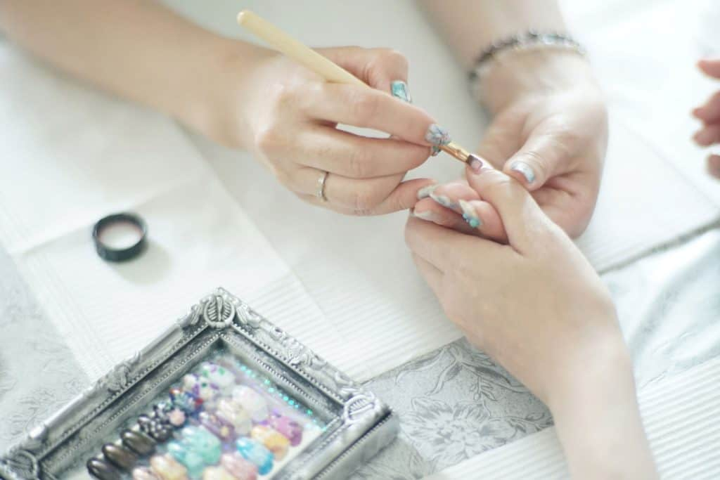 Woman receiving a manicure in a nail salon