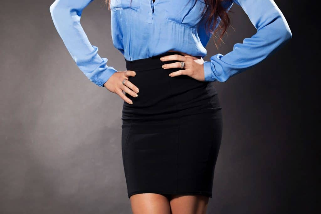 businesswoman weearing blue polo and black skirt, What To Wear With A Black Pencil Skirt [11 Outfit Ideas]