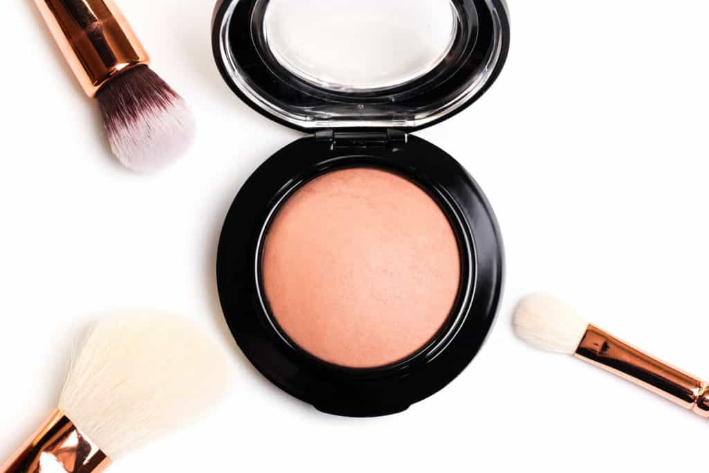 eye shadow, blush, powder, sculptor in a pack with make up brushes on a white background. Isolated on white. - Image
