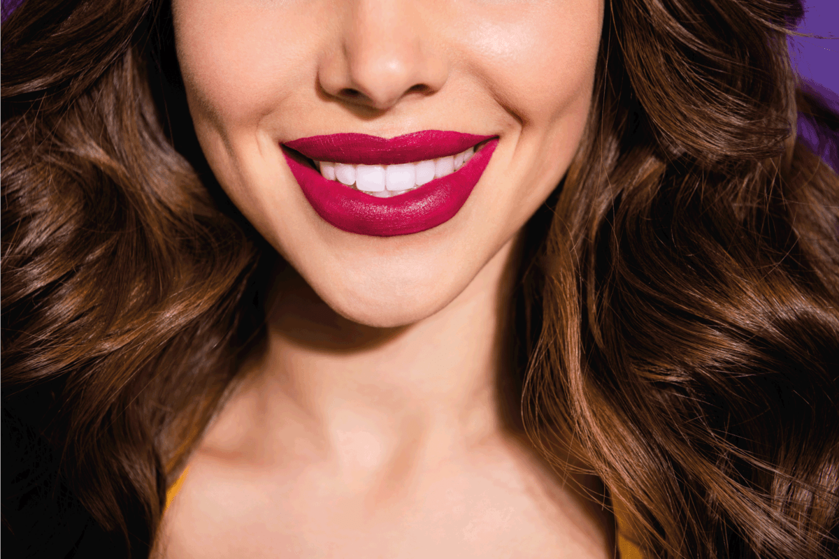 wavy-haired lady with plump sensual lips wearing burgundy lipstick