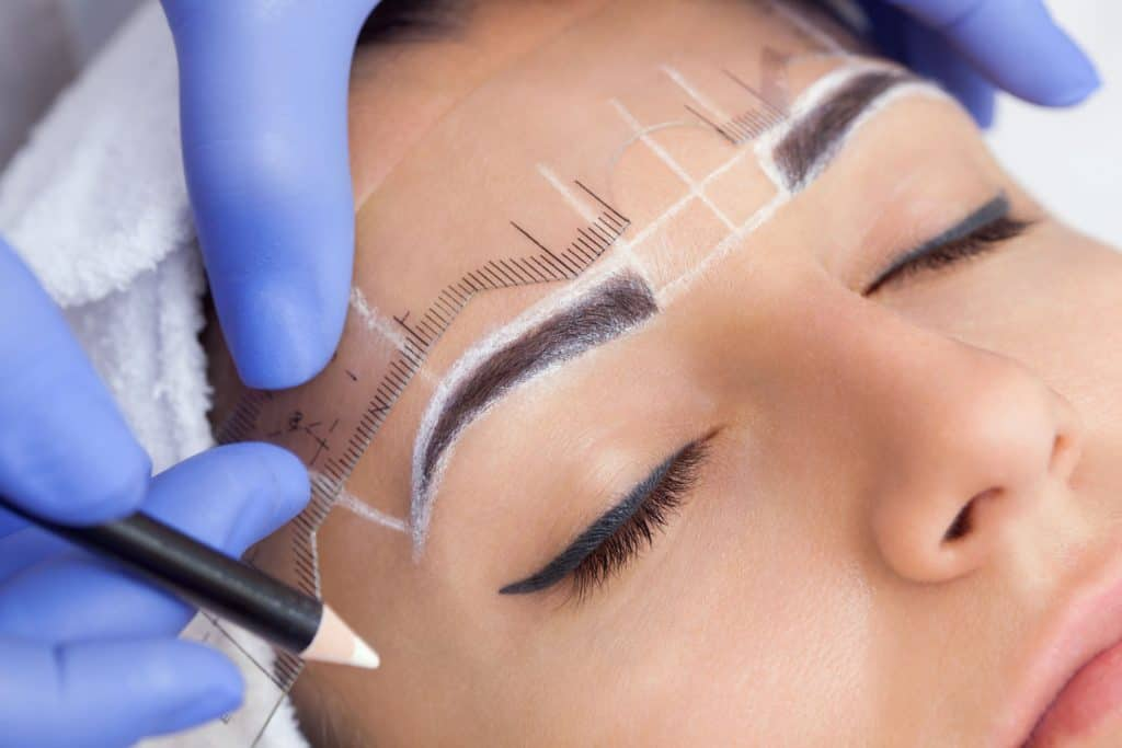 A beautiful woman getting a permanent eyebrow make up, Can Microblading Fix Uneven Eyebrows?