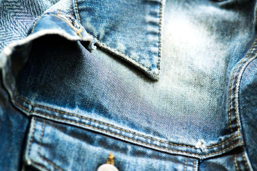 An up close photo of a denim jacket