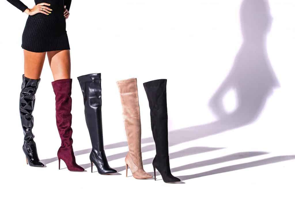 Black hessian boots on the legs of the model