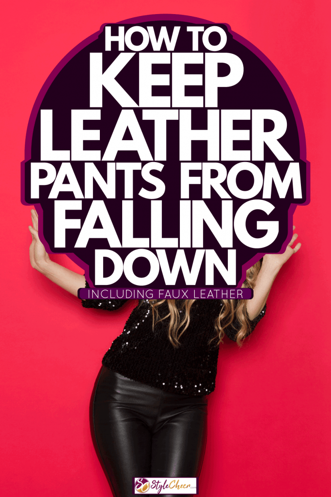 A happy woman wearing leather pants and a black blouse on a red background, How To Keep Leather Pants From Falling Down [Inc. Faux Leather]
