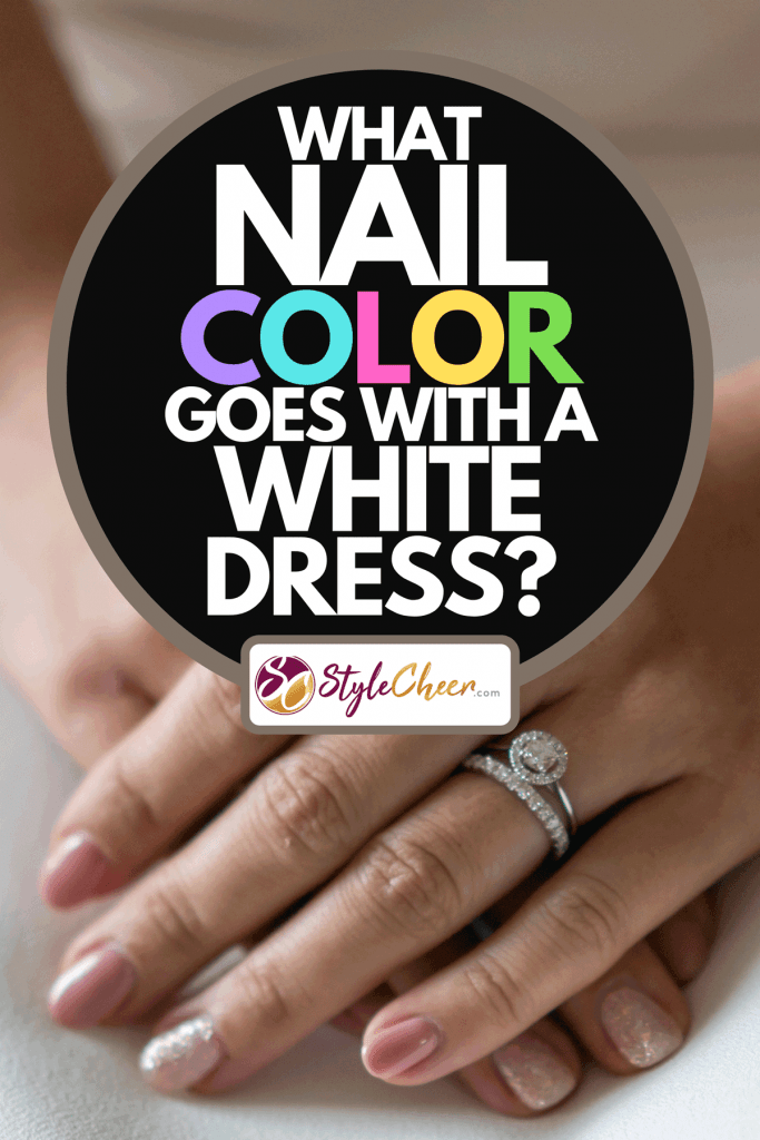 A woman with pink nails dressed in white wedding dress, What Nail Color Goes With A White Dress?