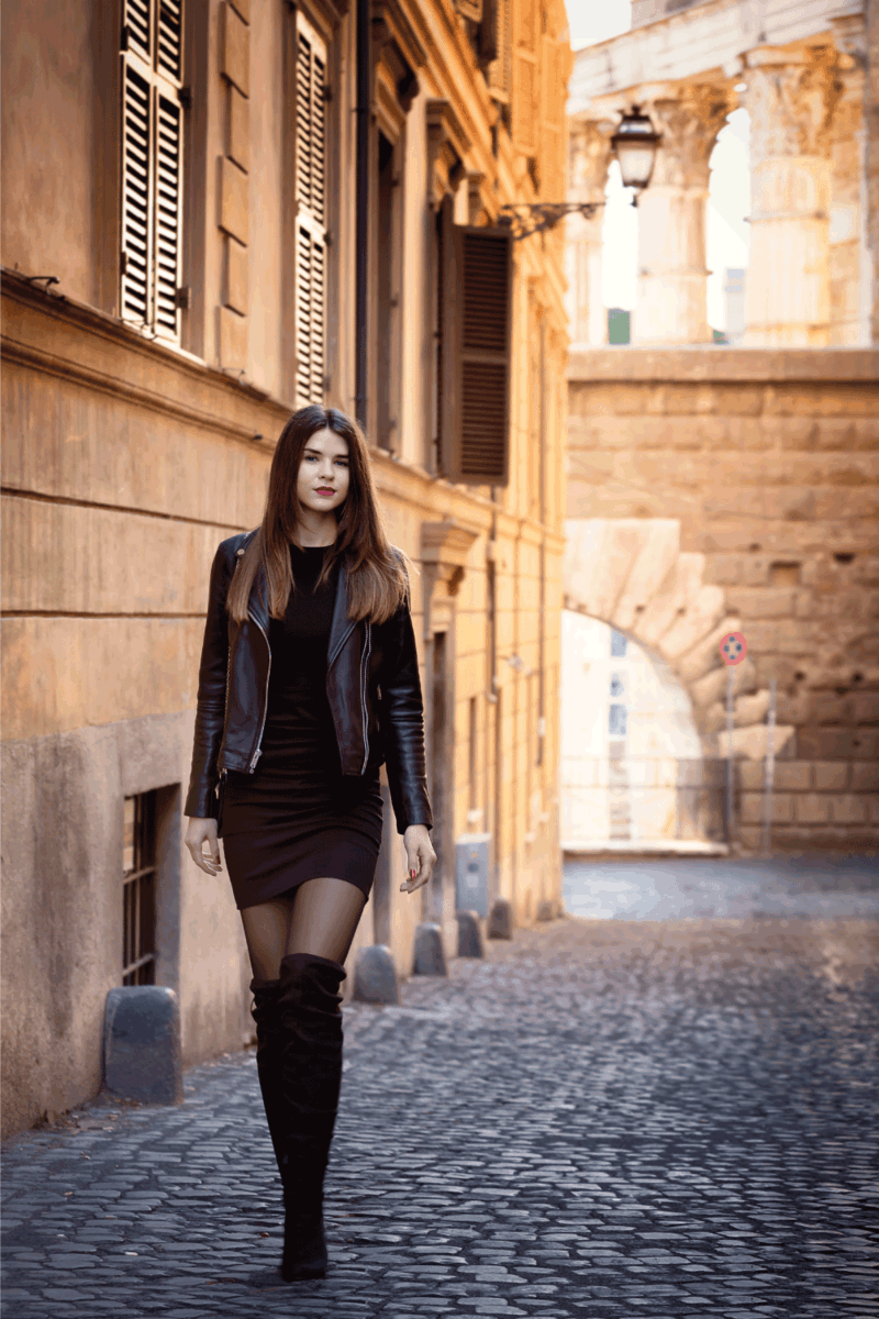 girl, tall, with long brown hair and gray eyes, walks through the streets wearing high boots