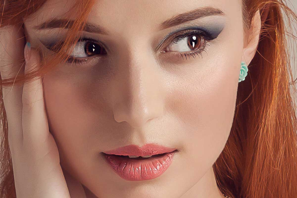 A beautiful portrait of a woman with copper hair, What Color Lipstick Goes With Copper Hair?