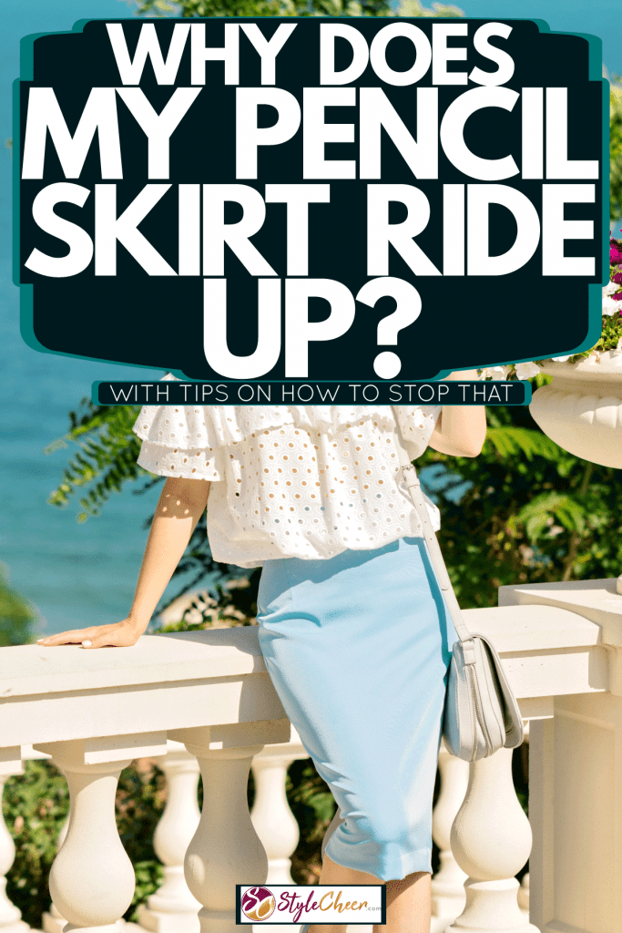 A beautiful woman wearing a white dotted blouse and blue pencil skirt, Why Does My Pencil Skirt Ride Up? [With Tips On How To Stop That]